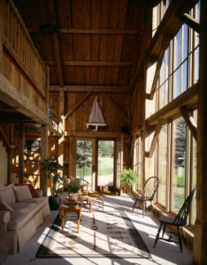 Rustic barn home with reclaimed timber work and large windows and expansive views of the Western landscape.