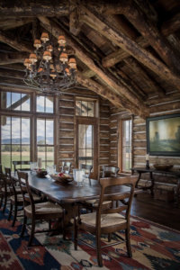 Mountain lodge dining area with expansive views of the western landscape near the Ruby River in Montana.