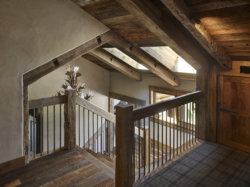 With it's hewn timber and plaster walls interiors, various levels respond to the natural slope of the landscape.